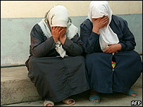 Survivors of a massacre in 1997 (Photo Hocine/AFP/Getty Images)