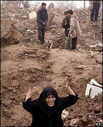 Woman cries amid rubble in Dahoueieh