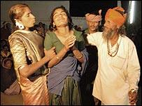 The witchdoctor (r) exorcises Rukmani. Pics: Prakash Hatbalne
