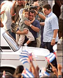 Elian and his father are greeted on their arrival in Havana, June 2000