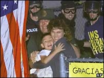 Elian (centre) is seized from his Miami relatives' home