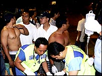 Ambulance workers attend to Bali blast victims