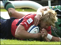 Gary Connolly crashes over for the first of his two tries for Munster