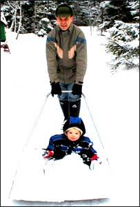 Esa with son Rowan in the snow
