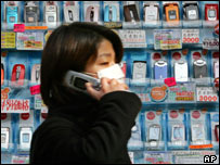 Chinese woman in front of mobile display, AP
