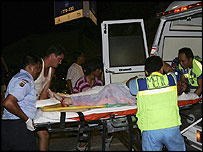 Medics evacuate an injured tourist from Jimbaran Beach