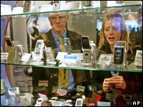Phones on display at 3GSM show, AP