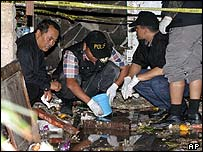 Forensic scientists comb the wreckage
