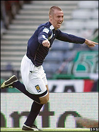 Kenny Miller in action for Scotland