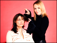 "Sarah Parish as Allie Henshall and Amanda Holden as Mia Bevan in series two of the hairdressing drama 'Cutting It""."