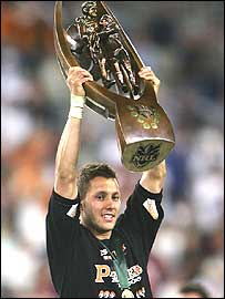 Wests Tigers captain Scott Prince lifts the NRL trophy