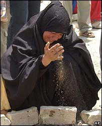 An Iraqi woman mourns the death of her child in a Baghdad bombing in July