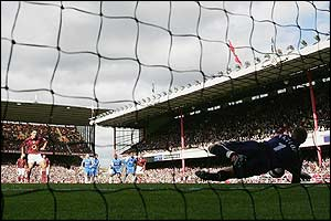 Maik Taylor saves from Robert Pires' penalty