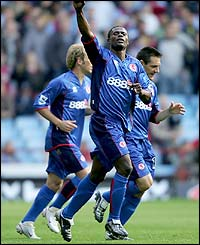 George Boateng celebrates after scoring Middlesbrough's second goal against Villa