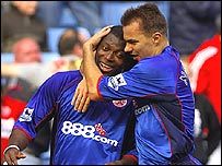 Yakubu celebrates with Szilard Nemeth