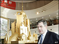 Gordon Brown with a model of Shanghai