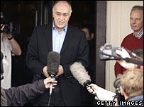 Michael Howard speaking to the press in Blackpool as Francis Maude looks on