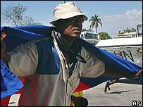 A supporter of former President Aristide protests in the Salino slum of the Haitian capital