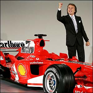 Ferrari president Luca di Montezemolo clenches his fist as he poses with the F2005
