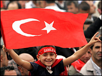 Turkish boy displays Turkish flag at an anti-EU rally in Ankara