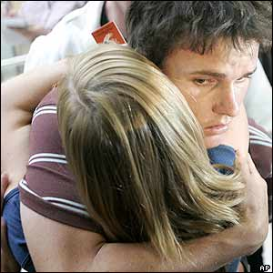 A man calling himself Jordan gets a hug at Sydney international airport in Australia