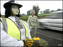 Stella Anderson and a police scarecrow slowing traffic in Middleton-in-Teesdale