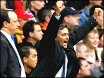 Jose Mourinho (right) celebrates while Rafael Benitez looks glum