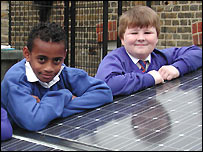 Bai and Stuart, 10, with the solar panels