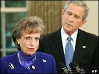 Harriet Miers with President Bush in the background