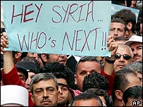 An anti-Syria sign held among a crowd in Beirut after the killing of Rafik Hariri