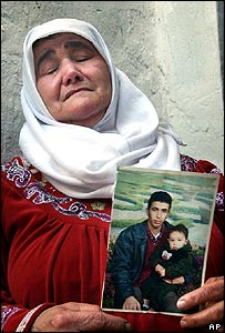 Rashida Badran, 53, holds a picture of her suicide bomber son, Abdullah Badran, 21