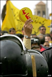 Protester in Cairo on 21 February brandishing Enough Of Mubarak logo