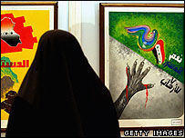 Iraqi woman looks at posters about Iraqi constitution