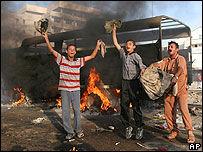 Residents of Ramadi celebrate an insurgency attack on Iraqi forces