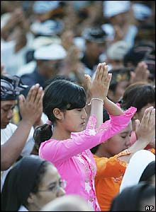 Indonesians take part in a cleansing ceremony
