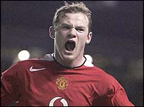 Wayne Rooney celebrates his second strike for Manchester United