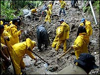 Rescue workers search for victims of a landslide in El Salvador