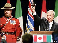 Canadian Prime Minister Paul Martin raises his glass during a speech