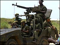 Congolese troops escorting the defence minister