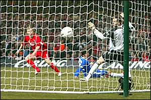 Liverpool's John Arne Riise scores past Chelsea keeper Petr Cech