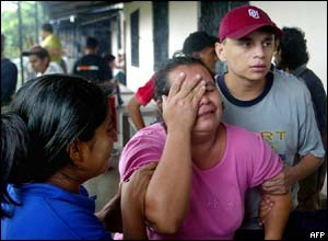 A woman cries for a relative killed in 12 de Abril community, El Salvador