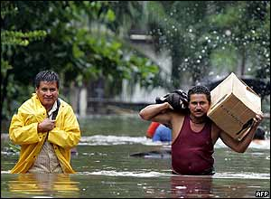 Two residents leave their homes in Puerto de San Jose, Guatemala