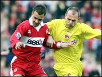 Szilard Nemeth of Middlesbrough battles with Charlton midfielder Danny Murphy