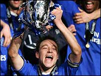 Chelsea captain John Terry raises the Carling Cup
