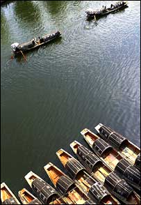 Image of boats on a river, taken by Jiancheng Dong