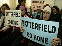 Protesters holding placards against US envoy Satterfield
