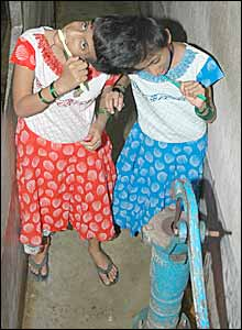 Conjoined Indian twins, Saba, left and Farah brushing their teeth at home in Patna (Picture by Prashant Ravi)