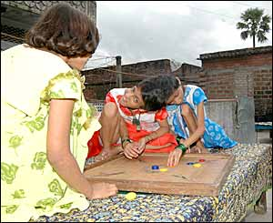 Saba, left and Farah playing a game of carrom with a friend at home in Patna (Picture by Prashant Ravi)