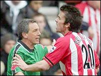 Southampton midfielder David Prutton manhandles referee Alan Wiley