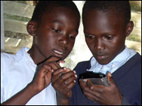 Kenyan schoolboys with handheld computers, EduVision